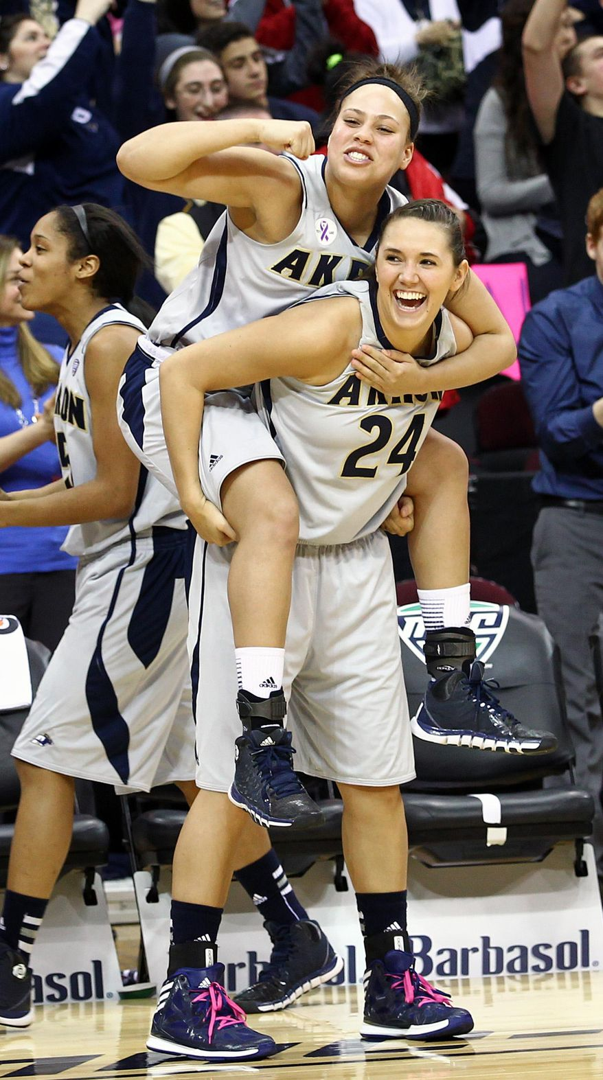 Akron's DiAndra Gibson, top, celebrates with teammate Katie Nunan after the Zips defeated Ball State 79-68 in an NCAA college basketball game in the championship of the Mid-American Conference tournament Saturday, March 15, 2014 in Cleveland. (AP Photo/Aaron Josefczyk)