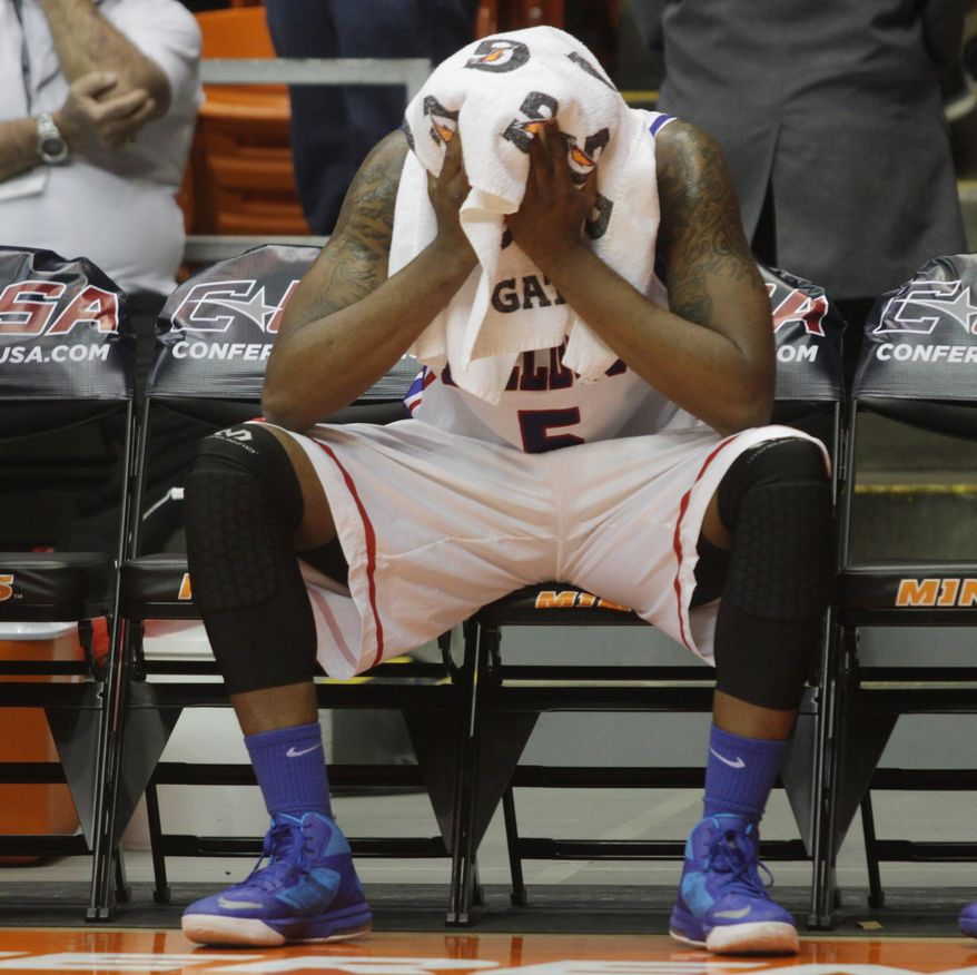 Louisiana Tech's Chris Anderson sits dejectedly on the bench as the final seconds ticked off during the second half of their 69-60 win loss to Tulsa in an NCAA college basketball game in the championship of the Conference USA tournament Saturday, March 15, 201,  in El Paso, Texas. (AP Photo/Victor Calzada)