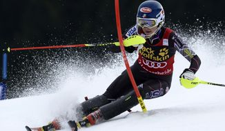 US athlete Mikaela Shiffrin clears a gate during the first run of the women's slalom race at the alpine skiing World Cup finals in Lenzerheide, Switzerland, Saturday, March 15, 2014. (AP Photo/Keystone, Jean-Christophe Bott)