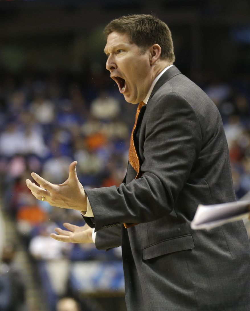 Clemson head coach Brad Brownell reacts to a call during the second half of a quarterfinal NCAA college basketball game against Duke at the Atlantic Coast Conference tournament in Greensboro, N.C., Friday, March 14, 2014. (AP Photo/Gerry Broome)