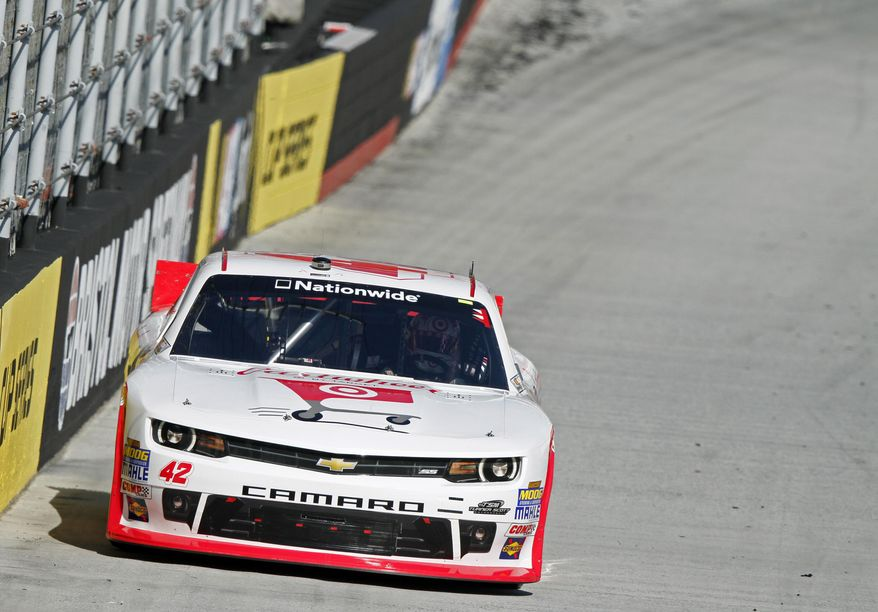 Driver Kyle Larson (42) makes his way around the track during qualifying for the NASCAR Nationwide series auto race at Bristol Motor Speedway on Saturday, March 15, 2014, in Bristol, Tenn. Larson will start from the pole position. (AP Photo/Wade Payne)