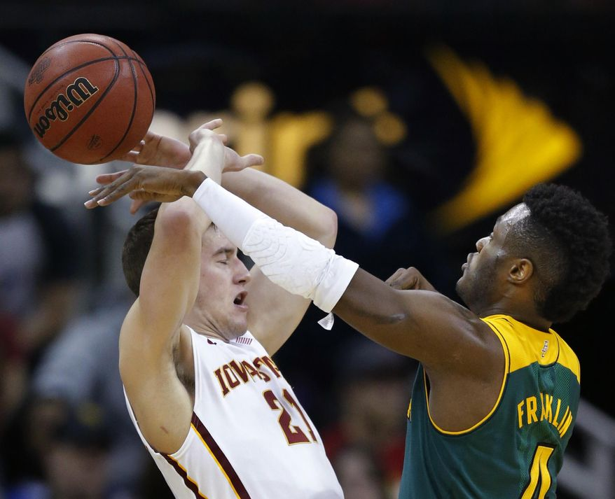 Baylor guard Gary Franklin, right, knocks the ball away from Iowa State guard Matt Thomas (21) during the first half of an NCAA college basketball game in the final of the Big 12 Conference men's tournament in Kansas City, Mo., Saturday, March 15, 2014. (AP Photo/Orlin Wagner)