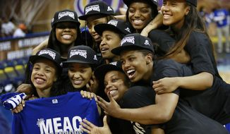 Hampton Lady Pirates celebrate after defeating Coppin State 50-47 in an NCAA college basketball game in Mid-Eastern Athletic Conference Championship tournament on Saturday, March 15, 2014, in Norfolk, Va. (AP Photo/The Virginian-Pilot, Stephen M. Katz)