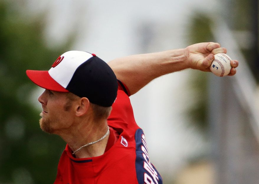 Washington Nationals starting pitcher Stephen Strasburg throws in the third inning of an exhibition spring training baseball game against the Miami Marlins, Saturday, March 15, 2014, in Jupiter, Fla. (AP Photo/David Goldman)