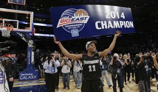 Providence's Bryce Cotton celebrates after an NCAA college basketball game against Creighton in the final of the Big East Conference men's tournament Saturday, March 15, 2014, at Madison Square Garden in New York. Providence won the game 65-58. (AP Photo/Frank Franklin II)