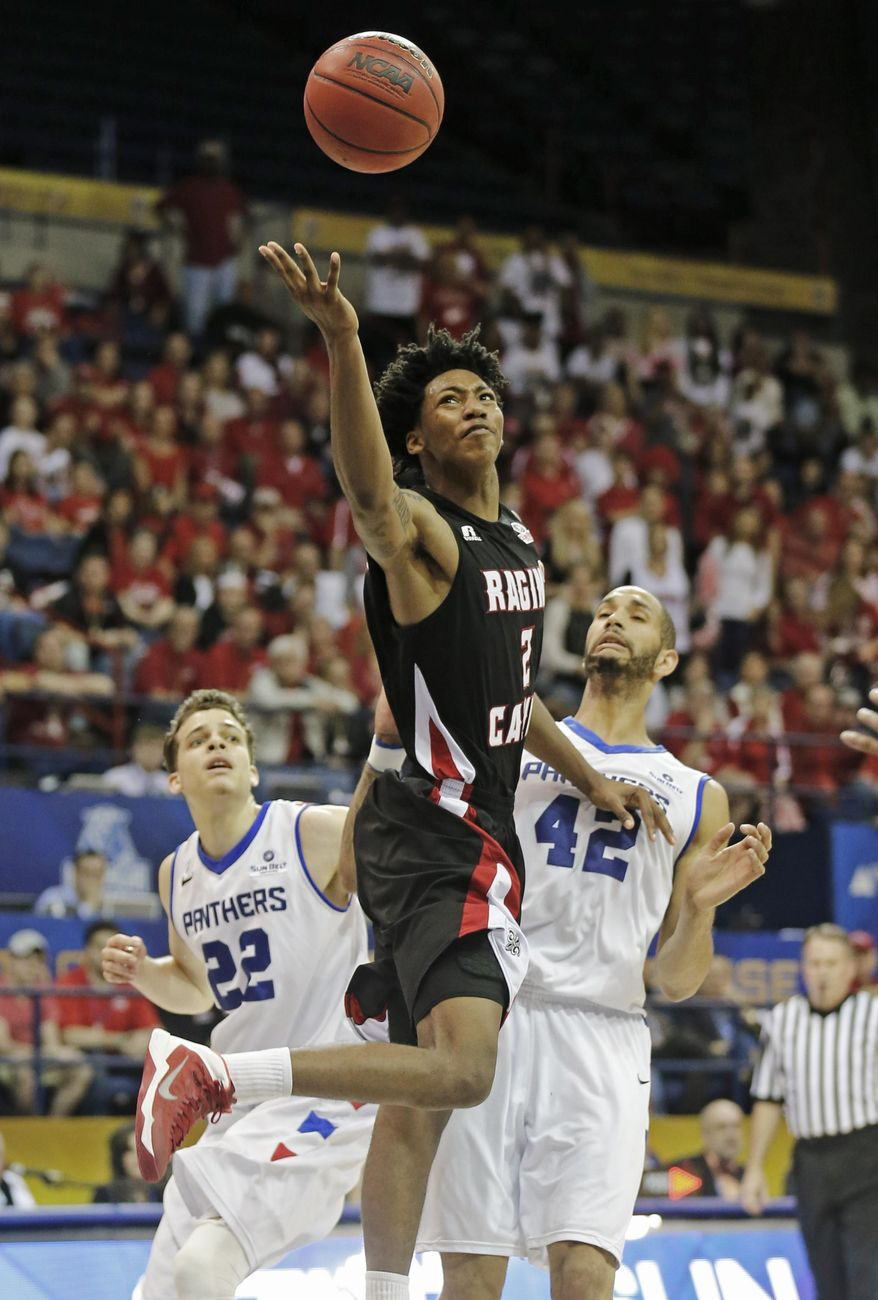 Louisiana Lafayette guard Elfrid Payton (2) goes to the basket in front of Georgia State forward Curtis Washington (42) and R.J. Hunter (22) in the first half of an NCAA college basketball game for the Sun Belt Conference tournament championship in New Orleans, Sunday, March 16, 2014. (AP Photo/Bill Haber)