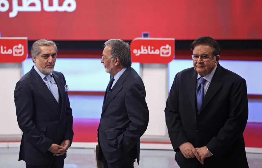 FILE - In this Tuesday, Feb. 4, 2014 file photo, Afghanistan presidential election candidates, from left, runner-up in the 2009 election, Abdullah Abdullah, former Foreign Minister Zalmai Rassoul and former Defense Minister Abdul Rahim Wardak attend the first presidential election debate at the Tolo TV building in Kabul, Afghanistan. Wardak, a longtime defense minister until he was removed by parliament in a vote of no confidence in 2012, gave no reason for his withdrawal and he was not throwing his support behind any remaining candidates, he said Sunday, March 16. (AP Photo/Massoud Hossaini, File)