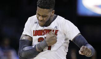 Louisville forward Montrezl Harrell celebrates after scoring against Connecticut during the second half of an NCAA college basketball game in the final of the American Athletic Conference men's tournament Saturday, March 15, 2014, in Memphis, Tenn. Louisville won 71-61. (AP Photo/Mark Humphrey)