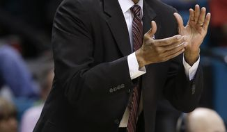 Stanford coach Johnny Dawkins encourages his team in the first half of an NCAA Pac-12 conference tournament quarterfinal college basketball game against Arizona State, Thursday, March 13, 2014, in Las Vegas. Stanford won 79-58. (AP Photo/Julie Jacobson)