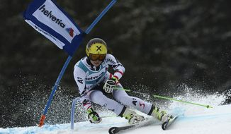 Anna Fenninger of Austria clears a gate during the first run during of the women's giant slalom race at the alpine skiing World Cup finals in Lenzerheide, Switzerland, Sunday, March 16, 2014. (AP Photo/Keystone, Jean-Christophe Bott)