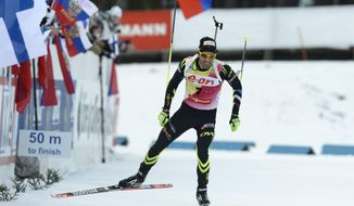 Second placed Martin Fourcade of France in action during the men's 10 km sprint competition at the IBU World Cup Biathlon in Kontiolahti, Finland, Thursday, March 13, 2014. (AP Photo/Heikki Saukkomaa, LEHTIKUVA)    FINLAND OUT