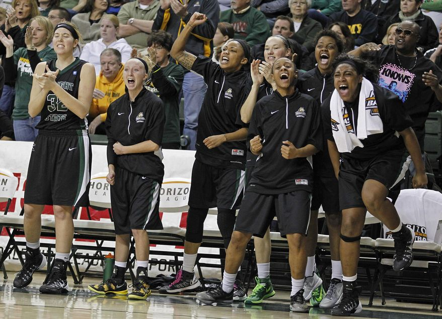 Wright State Raiders players react to their team taking the lead against Green Bay during the first half of an NCAA college basketball game for the Horizon League tournament championship on Sunday March 16, 2014, in Green Bay, Wis. (AP Photo/Matt Ludtke)