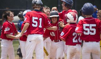 File-This June 29, 2013, file photo shows Newport Beach's Brennan Carroll (48) being mobbed by his teammates after he hit a home run  in a game featuring  Newport Beach Little League 11-year-old All Stars against the Laguna Niguel Little League 11-year-old All Stars. The league has been suspended indefinitely for reportedly not complying with rules and regulations of Little League Baseball. (AP Photo/The Orange County Register, Kyusung Gong)