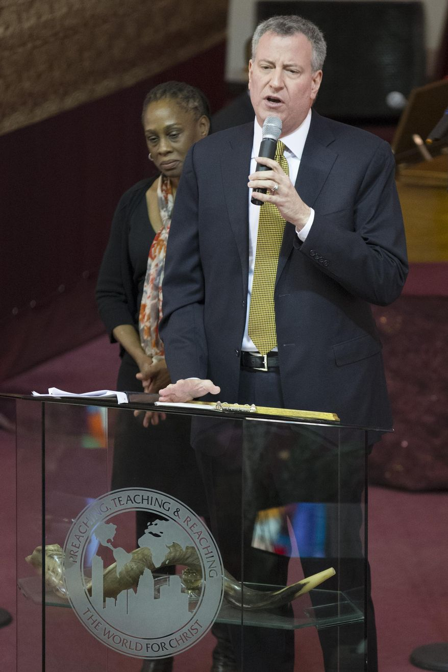 """New York City Mayor Bill de Blasio speaks alongside his wife Chirlane McCray during Sunday services at the Bethel Gospel Assembly as the congregation mourns the deaths of two members in Wednesday's explosions in the East Harlem neighborhood of New York, Sunday, March 16, 2014. De Blasio said the women lost """"were examples to all of us"""" because of the faith and spirit they demonstrated. (AP Photo/John Minchillo)"""