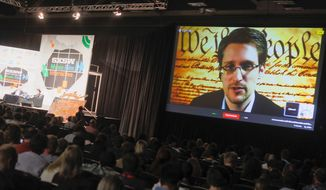 One specialist on background checks said that if the Office of Personnel Management allowed investigators to troll online, they could have spotted troubling signs with Edward Snowden, the former government contractor who leaked details of many of the government's most secret spy programs. (Associated Press)