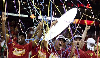 Iowa State's basketball team celebrates after their Big 12 Tournament championship win against Baylor, Saturday, March 15, 2014, in Kansas City, Mo. (AP Photo/The Daily Texan, Shelby Tauber)