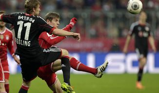 Leverkusen's Stefan Kiessling, left, and Bayern's Toni Kroos challenge for the ball during the German first division Bundesliga soccer match between FC Bayern Munich and Bayer 04 Leverkusen, in Munich, southern Germany, Saturday March 15, 2014. (AP Photo/Matthias Schrader)