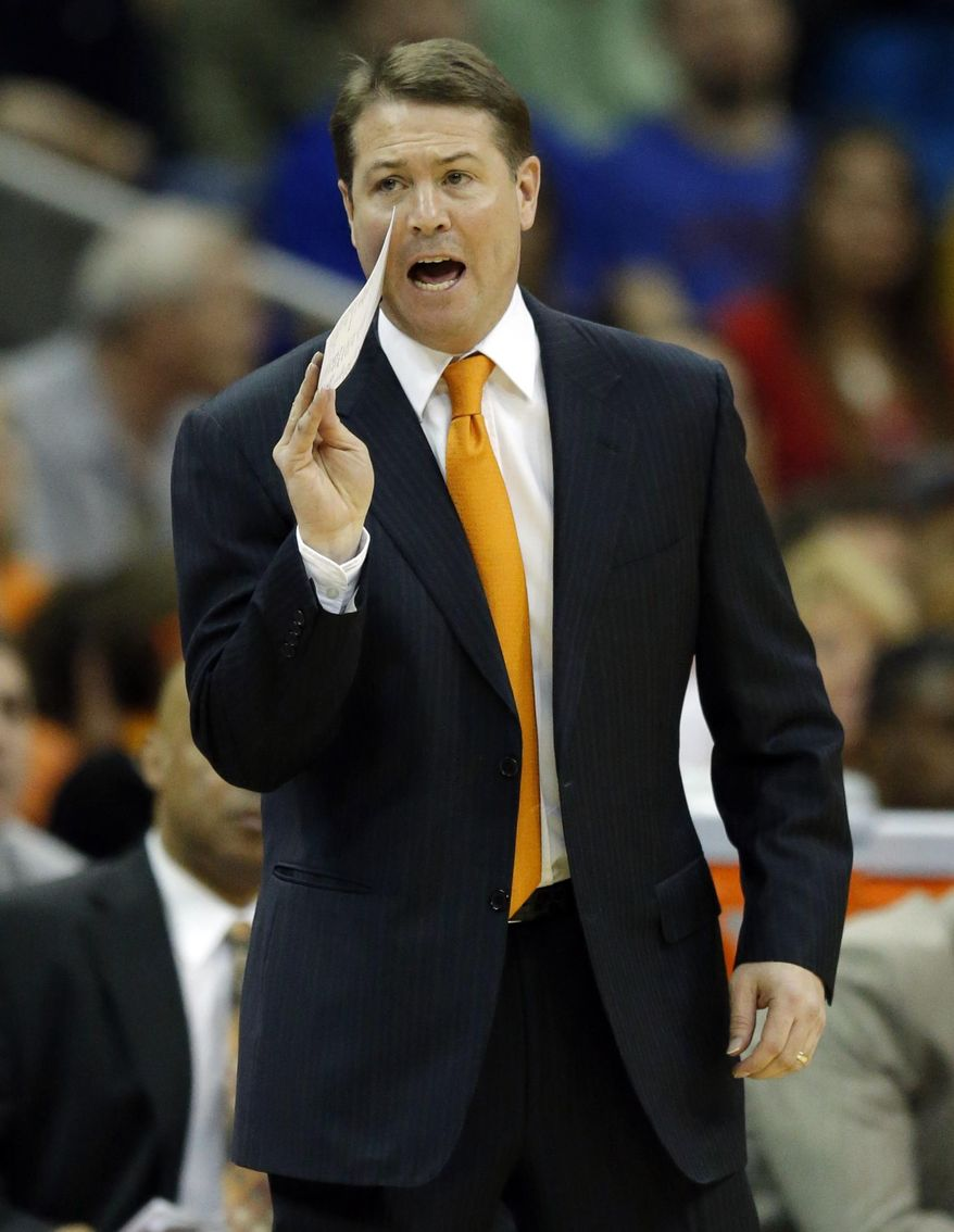 Oklahoma State head coach Travis Ford yells to his team during the first half of an NCAA college basketball game against Kansas in the quarterfinals of the Big 12 Conference men's tournament in Kansas City, Mo., Thursday, March 13, 2014. (AP Photo/Orlin Wagner)