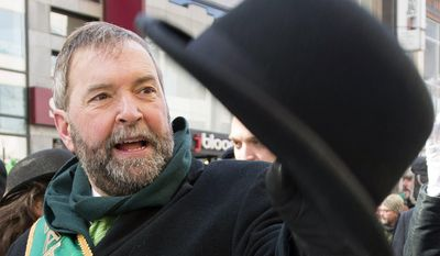 New Democratic Party leader Thomas Mulcair waves to spectators as he takes part in the the annual St. Patrick's Day parade in Montreal, Sunday, March 16, 2014. (AP Photo/The Canadian Press, Graham Hughes)