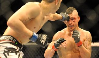 Myles Jury lands a punch on Diego Sanchez during a UFC 171 mixed martial arts lightweight bout, Saturday, March. 15, 2014, in Dallas. Jury won by decision. (AP Photo/Matt Strasen)