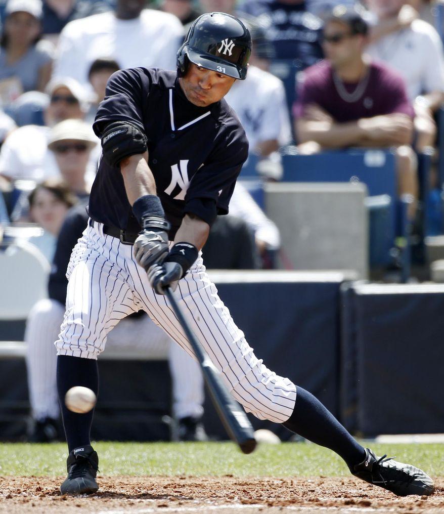 New York Yankees' Ichiro Suzuki hits a second-inning single off Atlanta Braves starting pitcher Julio Teheran in a spring exhibition baseball game in Tampa, Fla., Sunday, March 16, 2014. (AP Photo/Kathy Willens)