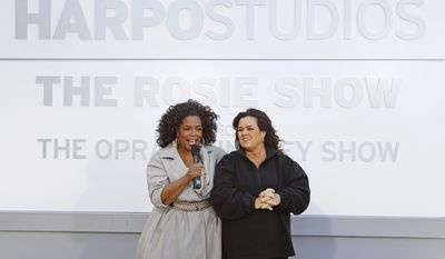 "FILE-This Sept. 15, 2011, file photo shows Rosie O'Donnell, right, and Oprah Winfrey speaking to the media after the unveiling of a new sign outside Harpo Studios welcoming ""The Rosie Show,"" to the studio  in Chicago.  Winfrey is selling Harpo Studios in Chicago to a developer, but the studio will remain on the property for another two years. Harpo Inc. said in a statement that it has entered into a purchasing agreement with Sterling Bay Cos. for the four-building campus on Chicago's West Side.  (AP Photo/M. Spencer Green, File)"