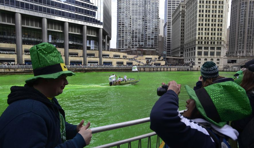 The Chicago River being dyed green ahead of the St. Patrick's Day parade in Chicago, Saturday, March 15, 2014. (AP Photo/ Paul Beaty)