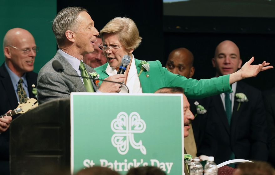 Sen. Elizabeth Warren, center right, sings with Rep. Stephen Lynch, center left, during the annual St. Patrick's Day Breakfast in Boston, Sunday, March 16, 2014.  (AP Photo/Michael Dwyer)