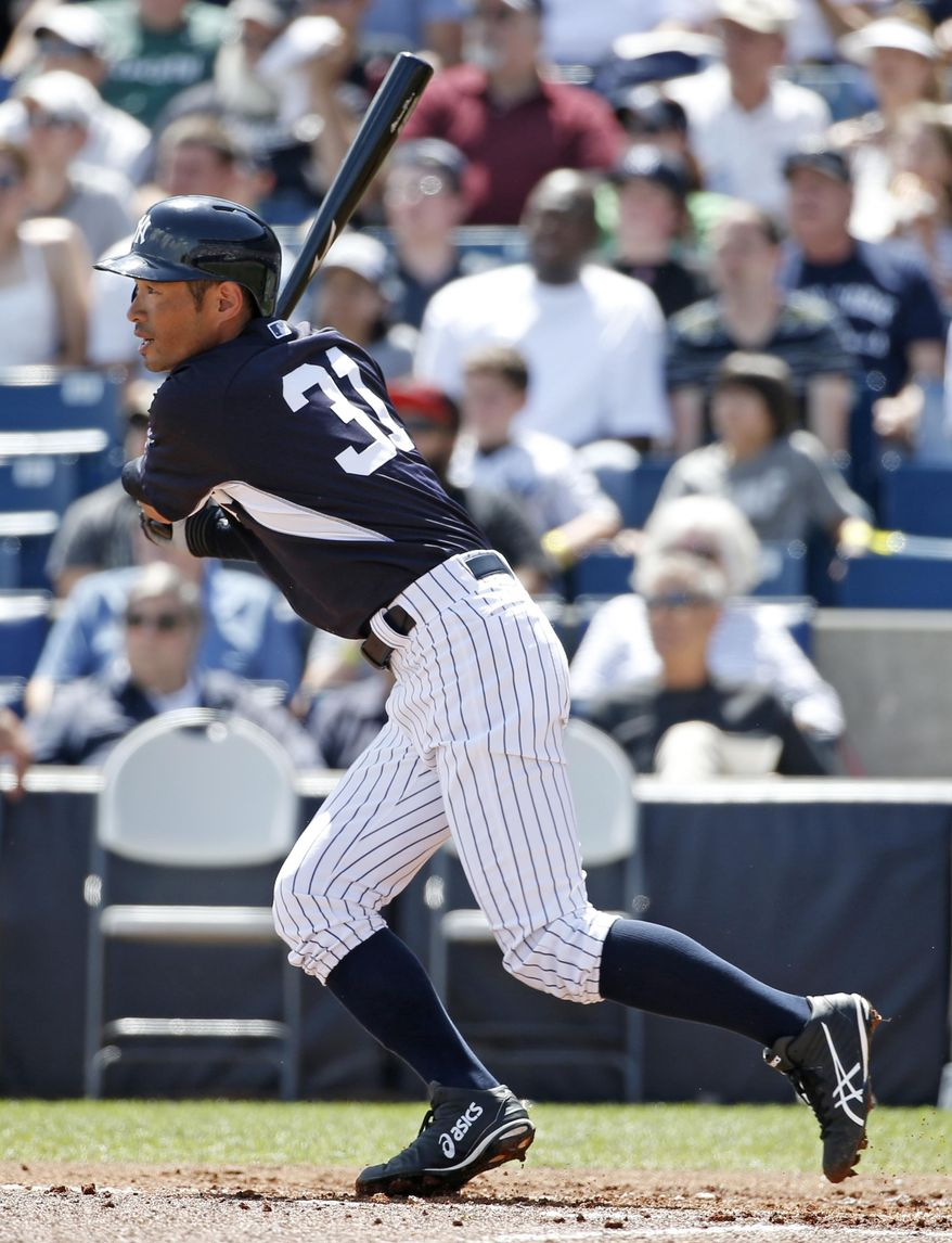 New York Yankees' Ichiro Suzuki hits a first-inning double off Atlanta Braves starting pitcher Julio Teheran in a spring exhibition baseball game in Tampa, Fla., Sunday, March 16, 2014. (AP Photo/Kathy Willens)