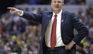 Ohio State head coach Thad Matta directs his team in the first half of an NCAA college basketball game against Michigan in the semifinals of the Big Ten Conference tournament Saturday, March 15, 2014, in Indianapolis. (AP Photo/Michael Conroy)