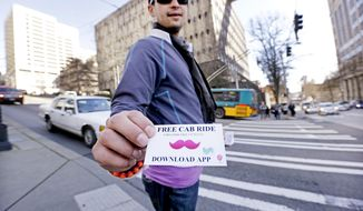 In this photo taken Friday, March 14, 2014, Jerad Bernard hands out cards to passersby offering one free ride through the Lyft ridesharing service in Seattle. In a fight pitting upstart technology and traditional business, app-based car share companies and traditional taxis are fighting for supremacy in Seattle. The taxi industry say companies like Uber and Lyft undercut their businesses because they are not regulated. Uber and Lyft say they provide services and convenience that taxis sorely lack. (AP Photo/Elaine Thompson)
