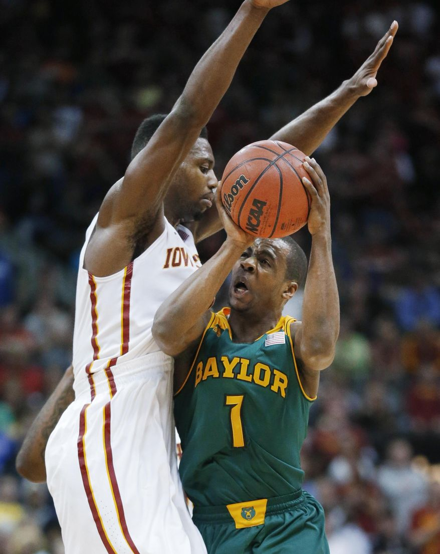 Baylor guard Kenny Chery (1) draws a foul from Iowa State forward Melvin Ejim,  left, during the first half of an NCAA college basketball game in the finals of the Big 12 Conference men's tournament in Kansas City, Mo., Saturday, March 15, 2014. (AP Photo/Orlin Wagner)