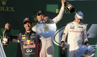From left, Red Bull driver Daniel Ricciardo of Australia, Mercedes driver Nico Rosberg of Germany and McLaren driver Kevin Magnussen of Denmark celebrate on the podium after the Australian Formula One Grand Prix at Albert Park in Melbourne, Australia, Sunday, March 16, 2014. Rosberg won the race ahead of Ricciardo and Magnussen. (AP Photo/Rob Griffith)