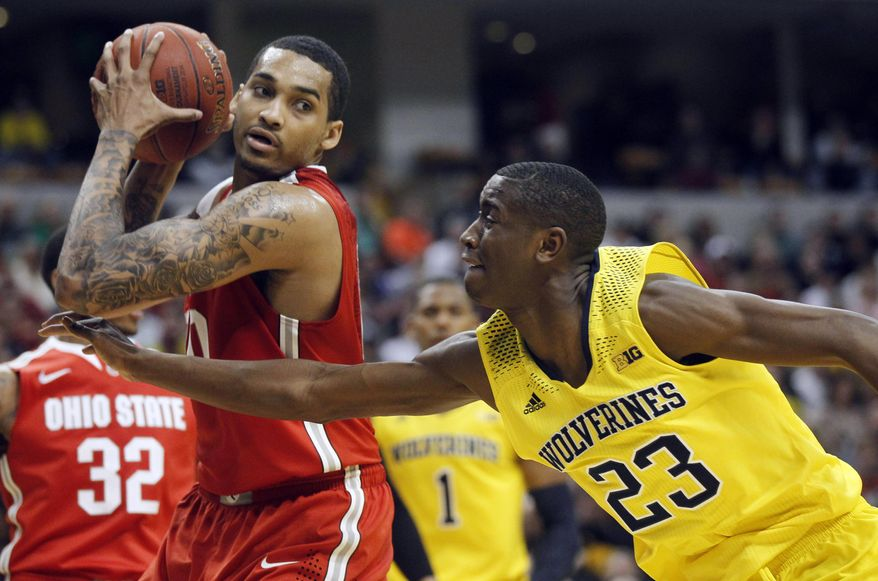 Ohio State forward LaQuinton Ross, left, grabs a rebound against Michigan guard Caris LeVert in the second half of an NCAA college basketball game in the semifinals of the Big Ten Conference tournament Saturday, March 15, 2014, in Indianapolis. Michigan won 72-69. (AP Photo/Kiichiro Sato)