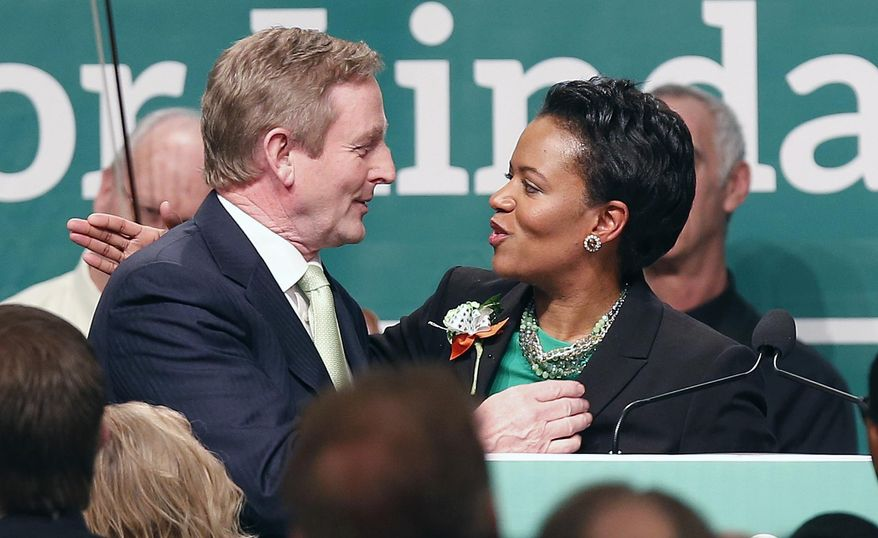 State Sen. Linda Dorcena Forry, right, thanks Prime Minister Enda Kenny of Ireland after Kenny spoke at the annual St. Patrick's Day Breakfast in Boston, Sunday, March 16, 2014.  (AP Photo/Michael Dwyer)