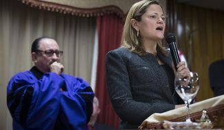 New York City Council Speaker Melissa Mark-Viverito speaks during Sunday services at the Church of God of Third Avenue as the congregation welcomed members of the Spanish Christian Church that was destroyed by Wednesday's explosion in the East Harlem neighborhood of New York, Sunday, March 16, 2014. The Spanish Christian Church had been located on the first floor of one of the destroyed buildings. On Saturday a crew at the blast site found a large Bible in the rubble and returned it to the church's pastor. (AP Photo/John Minchillo)