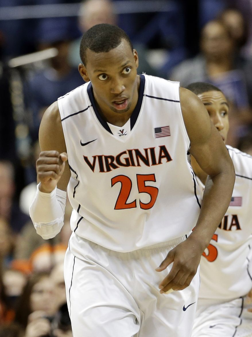 Virginia's Akil Mitchell reacts after making a basket against Duke during the second half of an NCAA college basketball game in the championship of the Atlantic Coast Conference tournament in Greensboro, N.C., Sunday, March 16, 2014. (AP Photo/Gerry Broome)