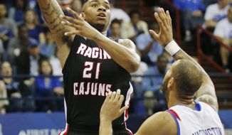 Louisiana Lafayette forward Shawn Long (21) shoots over Georgia State forward Curtis Washington (42) in the first half of an NCAA college basketball game for the Sun Belt Conference tournament championship in New Orleans, Sunday, March 16, 2014. (AP Photo/Bill Haber)