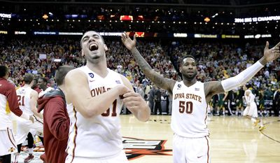 Iowa State Cyclones forward Georges Niang (31) and guard DeAndre Kane (50) celebrate the teams 74-65 win over the Baylor Bears during Sunday's Big 12 Basketball Tournament championship game at the Sprint Center on March 15, 2014 in Kansas City, Mo.