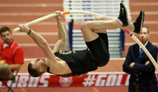 Oregon's Dakotah Keys competes in the pole vault portion of the decathlon during the NCAA Indoor Track and Field Championships, Sat, Mar 15, 2014, in Albuquerque, New Mexico. (AP Photo/The Oregonian, Thomas Boyd)