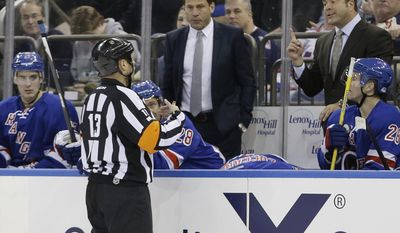New York Rangers' Alain Vigneault, upper right, argues a call with referee Dan O'Halloran (13) during the second period of an NHL hockey game against the San Jose Sharks, Sunday, March 16, 2014, in New York. (AP Photo/Frank Franklin II)