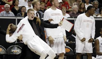 The San Diego State bench reacts to a basket during the second half of an NCAA college basketball game against New Mexico for the Mountain West Conference tournament championship on Saturday, March 15, 2014, in Las Vegas. New Mexico defeated San Diego State 64-58. (AP Photo/Isaac Brekken)