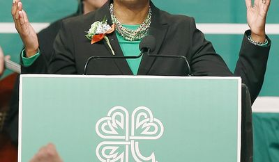 State Sen. Linda Dorcena Forry speaks during the annual St. Patrick's Day Breakfast in Boston, Sunday, March 16, 2014. (AP Photo/Michael Dwyer)