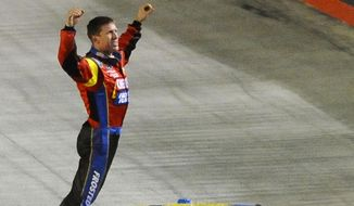 Driver Carl Edwards celebrates at the finish line after winning the NASCAR Sprint series auto race at Bristol Motor Speedway on Sunday, March 16, 2014, in Bristol, Tenn. (AP Photo/Andre Teague/Bristol Herald Courier)