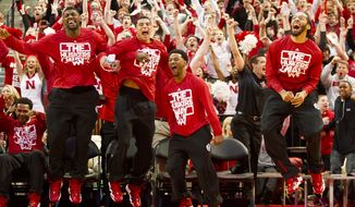 From left, Nebraska players Leslee Smith, Tai Webster, Benny Parker and Terran Petteway react seconds after the NCAA Selection Show announced Nebraska's spot in the NCAA tournament bracket at the Men's NCAA Selection Show Watch Party at PInnacle Bank Arena in Lincoln, Neb. on Sunday, March 16, 2014.  (AP Photo/The Journal-Star, Morgan Spiehs) LOCAL TV OUT; KOLN-TV OUT; KGIN-TV OUT; KLKN-TV OUT (