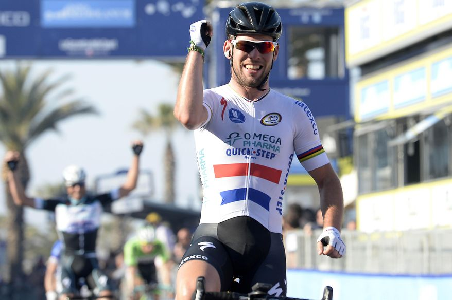 Britain's Mark Cavendish celebrates after winning the sixth stage of the Tirreno Adriatico cycling race, from Bucchianico to Porto Sant'Elpidio, Italy, Monday, March 17, 2014.  Mark Cavendish took advantage of a crash to easily win the sixth and penultimate stage of the Tirreno-Adriatico race Monday, and Alberto Contador maintained his overall lead. When several riders went down with little more than a kilometer to go, the pack split and Cavendish's Omega Pharma-Quick Step train was virtually alone in front. (AP Photo/Fabio Ferrari, Lapresse)