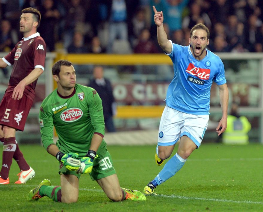 Napoli forward Gonzalo Higuain celebrates after scoring during a Serie A soccer match between Napoli and Torino, at the Olympic  stadium, in Turin, Italy, Monday, March 17, 2014. (AP Photo/Massimo Pinca)