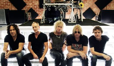 This May 31, 2012, file photo shows, from left, Vivian Campbell, Phil Collen, Rick Savage, Joe Elliott, and Rick Allen, of the musical group Def Leppard in Los Angeles. (Photo by Matt Sayles/Invision/AP, File)
