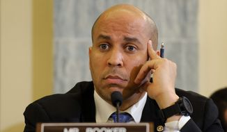 Sen. Cory Booker, New Jersey Democrat, says the newest proposed unemployment benefits bill is a step in the right direction in getting people long out of the labor force back to work. (Associated Press)
