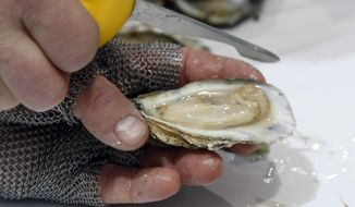 It's the dawn of oyster season, and D.C. area restaurants are serving up plenty of reasons to celebrate. (Associated Press/File)